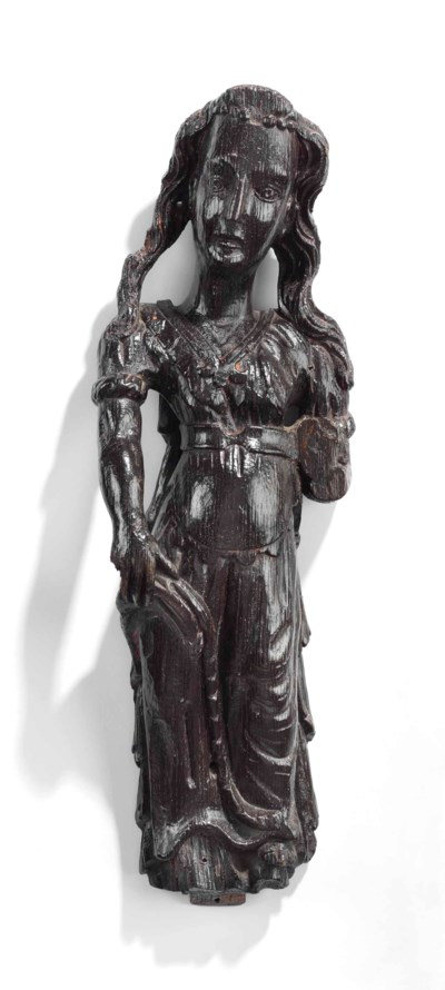 AN ENGLISH CARVED OAK FEMALE S