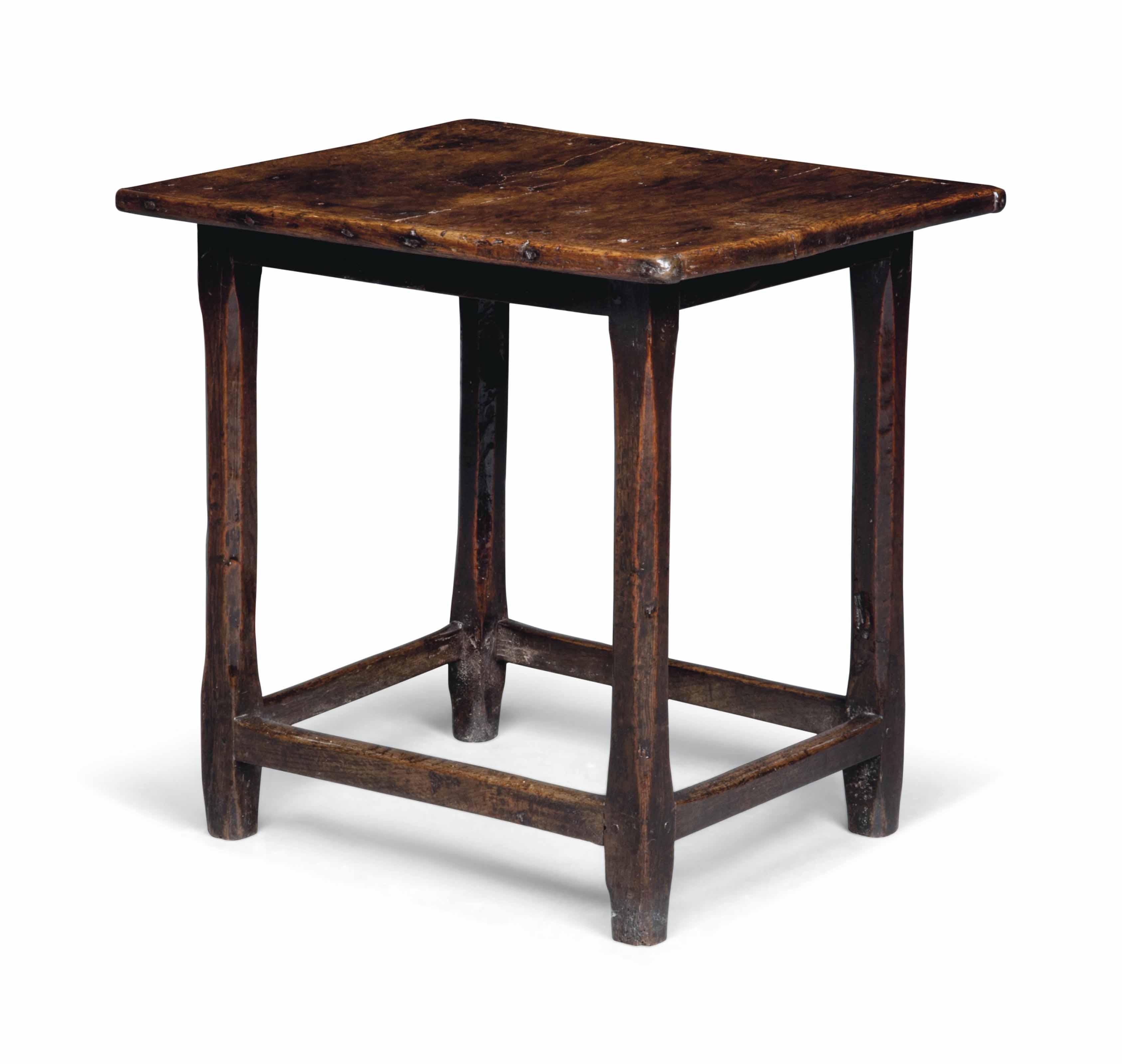 A SMALL OAK TABLE