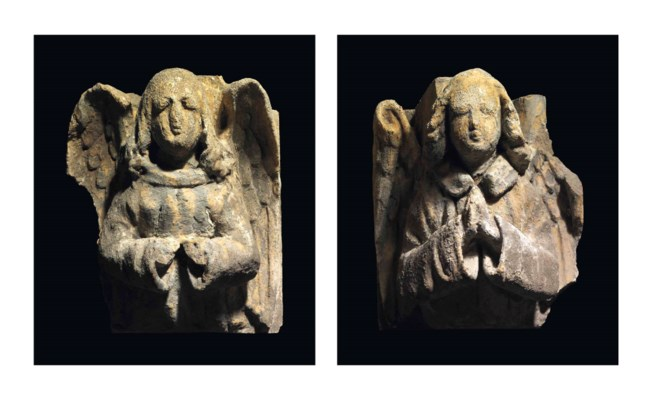 A PAIR OF STONE CORBELS IN THE