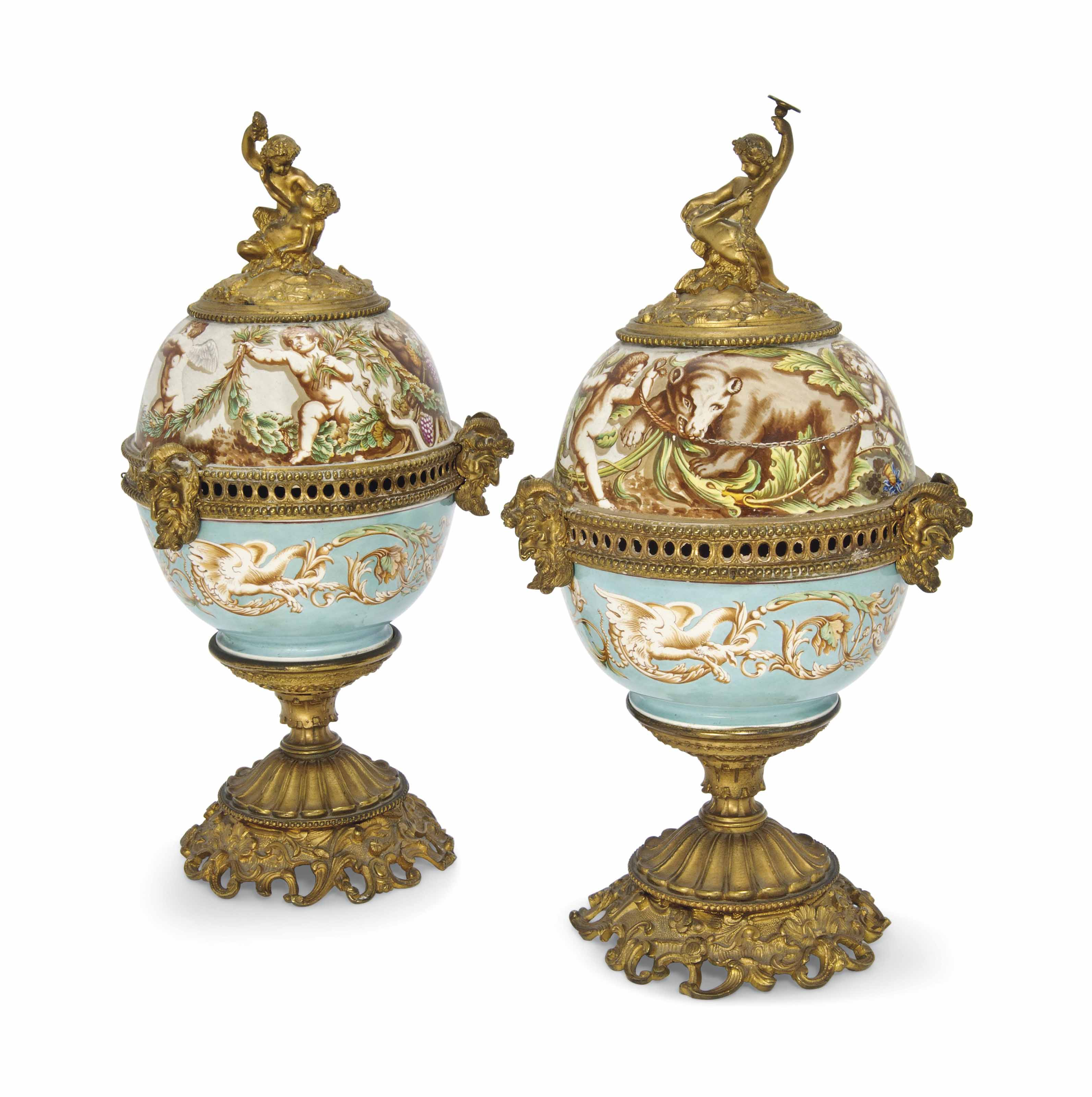 A PAIR OF CONTINENTAL PORCELAIN AND GILT-BRONZE MOUNTED URNS AND COVERS