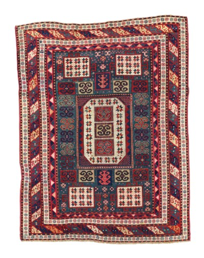 AN ANTIQUE KAZAK KARACHOPF RUG