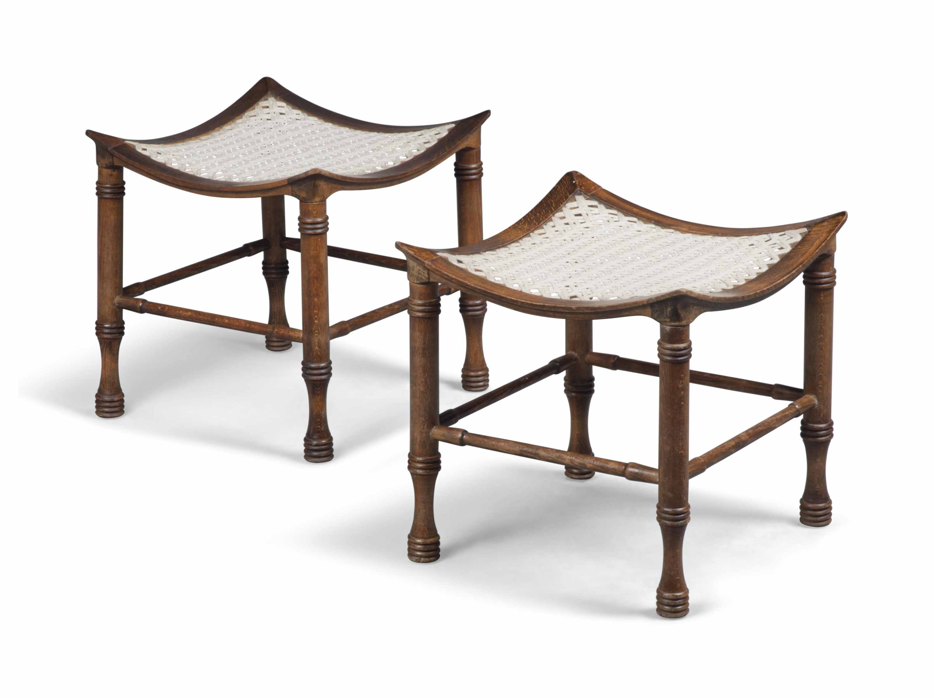 A PAIR OF 'THEBES' BEECH STOOLS ATTRIBUTED TO LIBERTY & CO