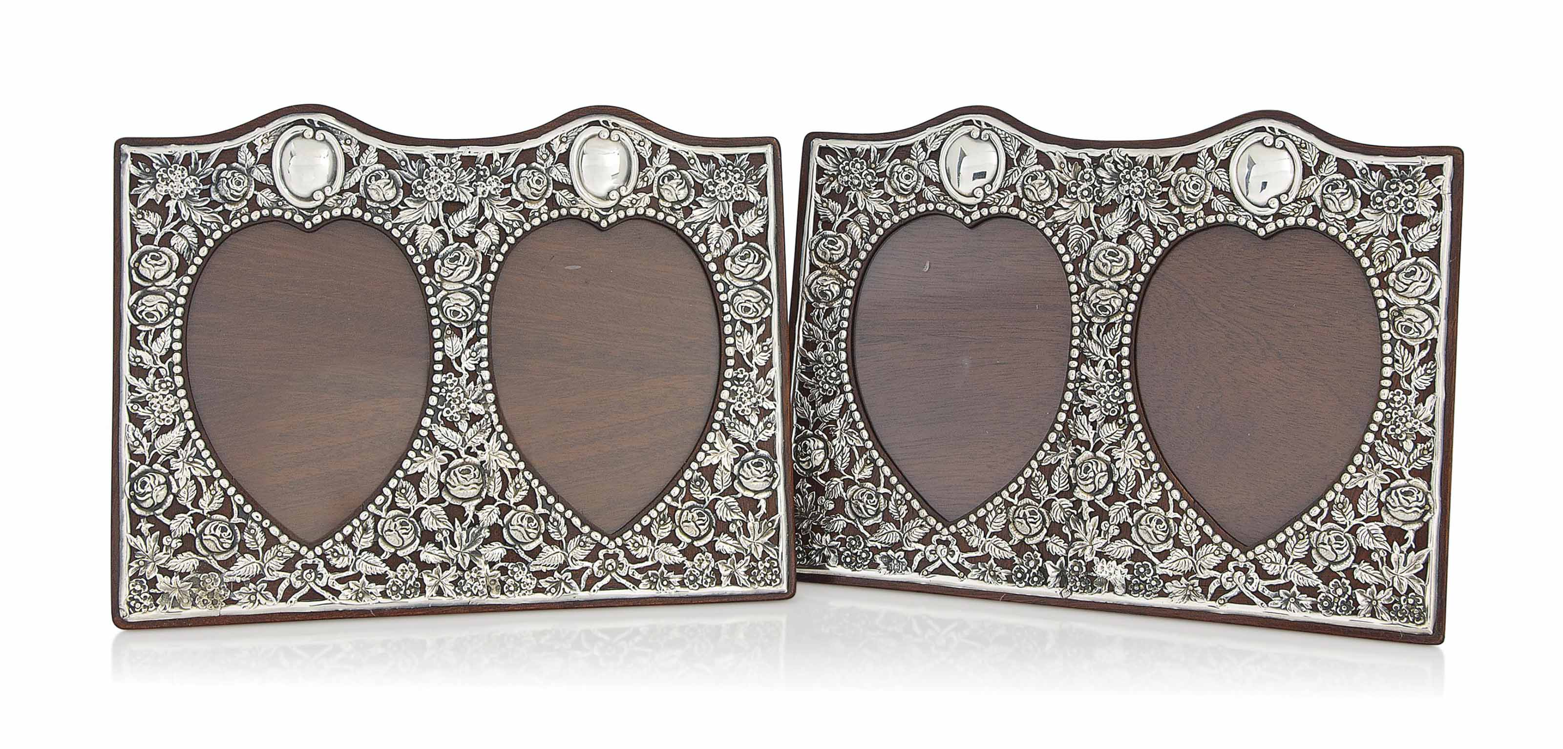 A MATCHED PAIR OF DOUBLE-HEART SILVER AMD MAHOGANY PHOTOGRAPH FRAMES