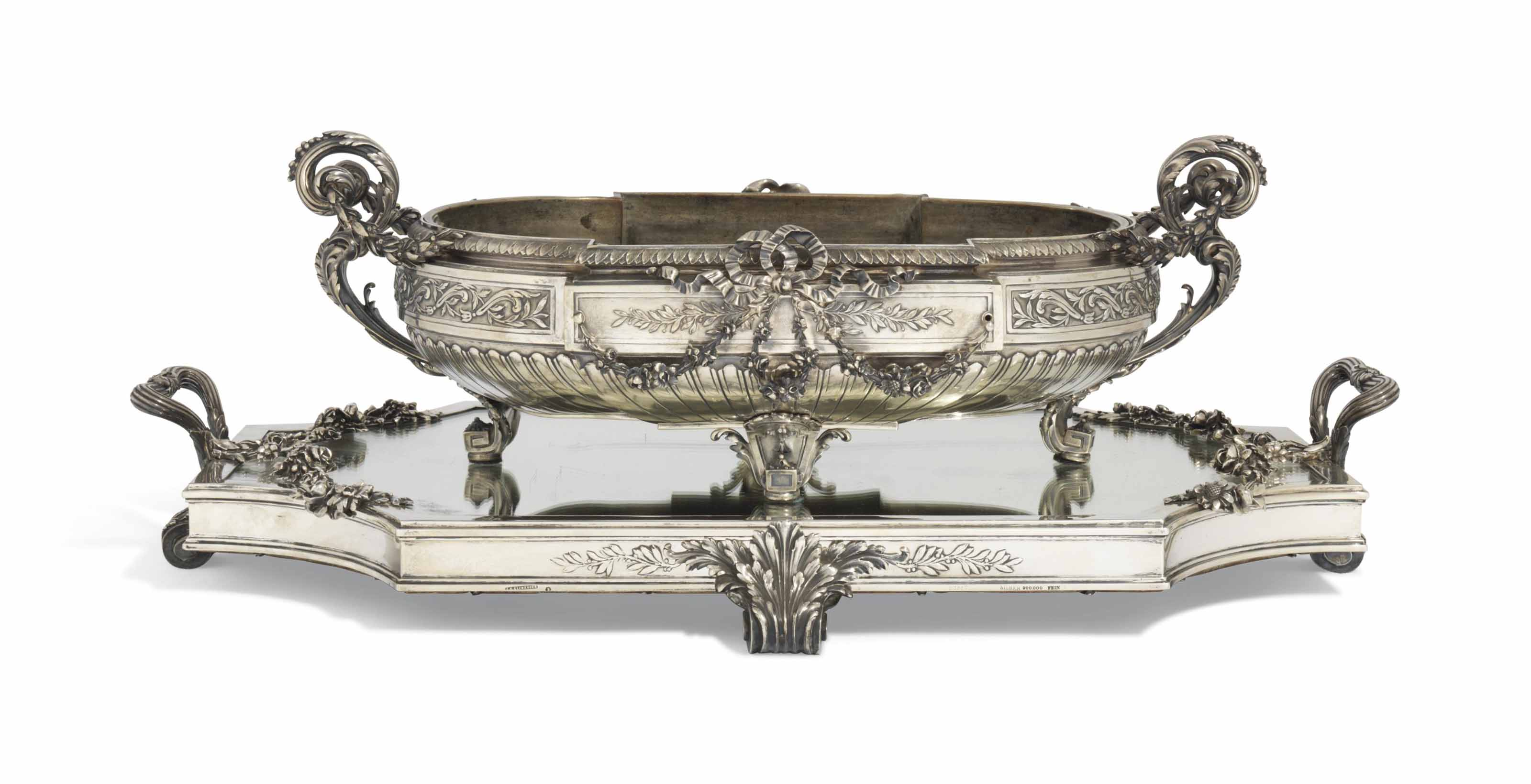 AN AUSTRIAN SILVER JARDINIERE AND MIRROR-PLATEAU