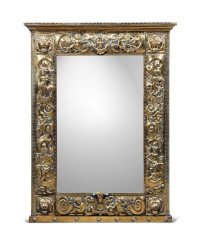 A BRASS REPOUSSE MIRROR