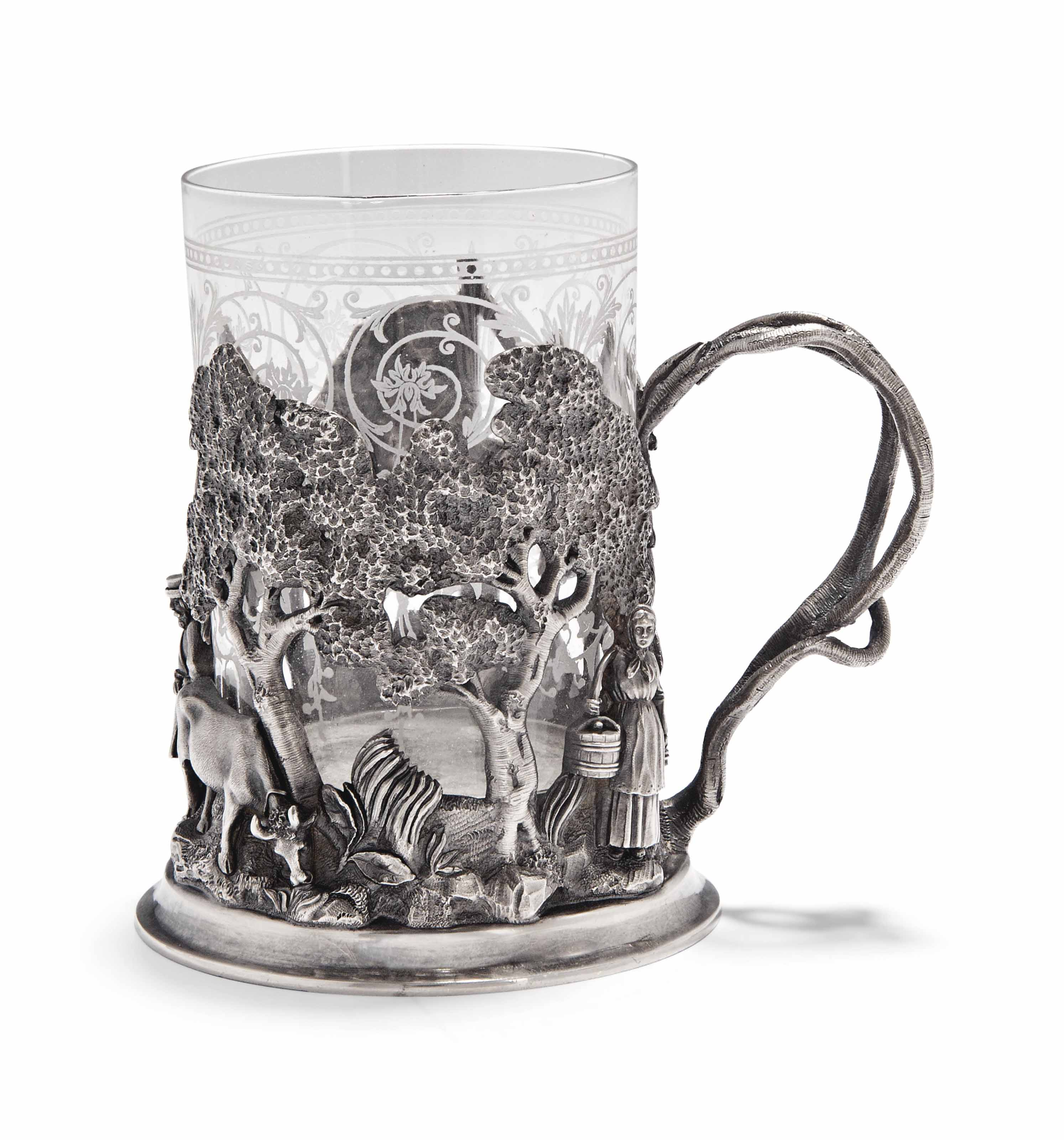 A RUSSIAN SILVER TEA-GLASS HOL