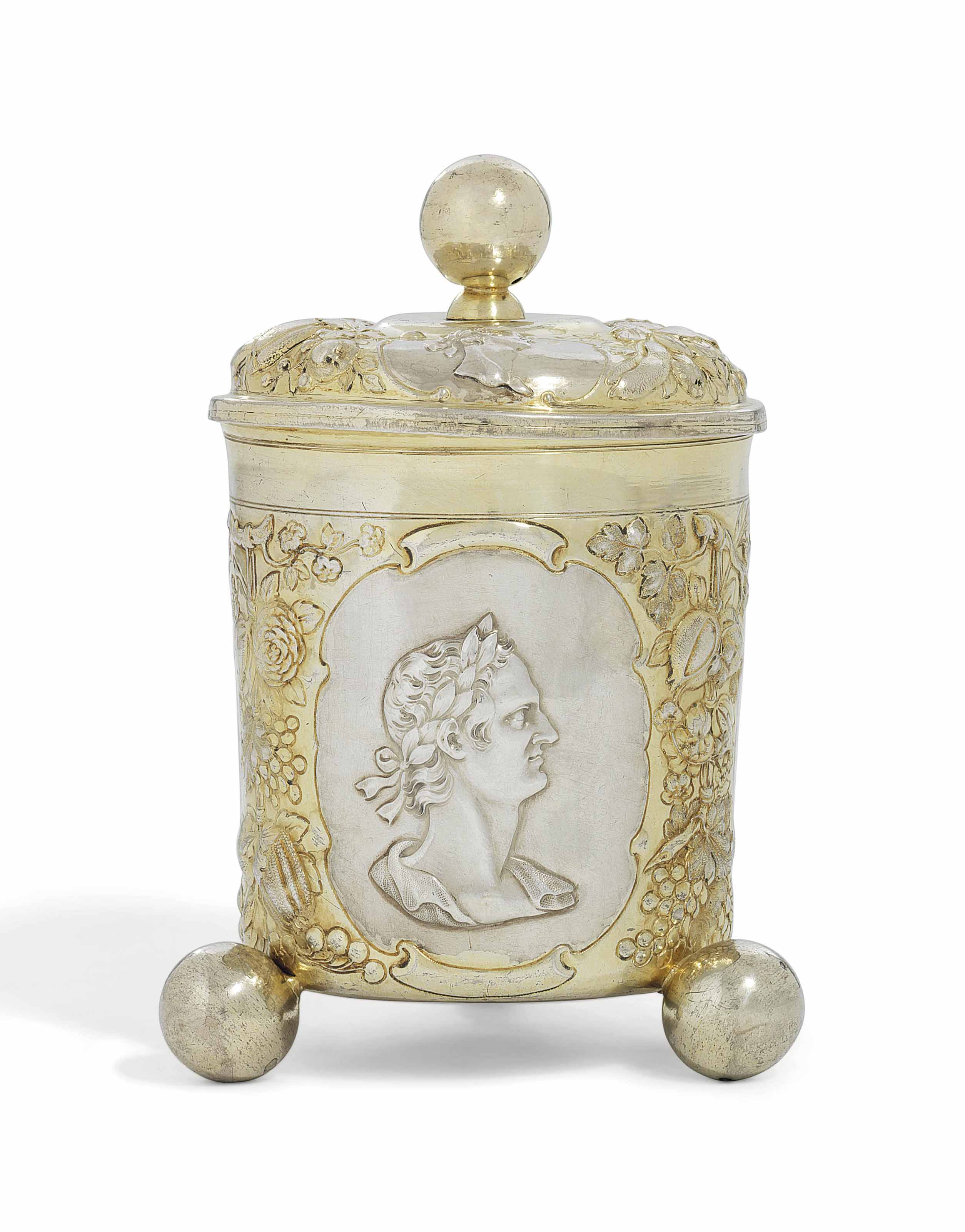 A GERMAN PARCEL-GILT SILVER CUP AND COVER