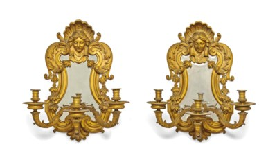 A SET OF FOUR GILT-BRONZE GIRA