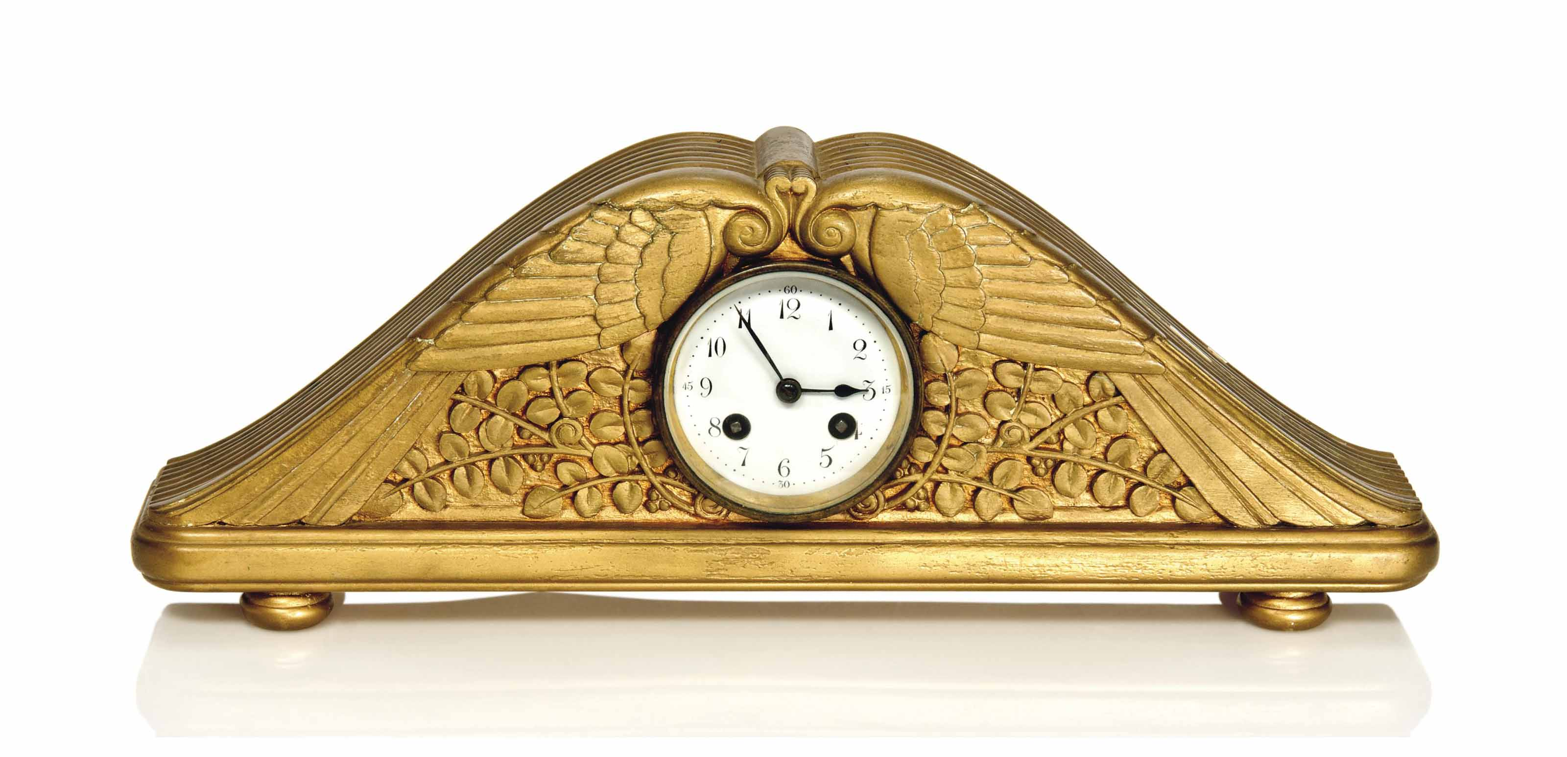 A CARVED GILTWOOD MANTLE CLOCK