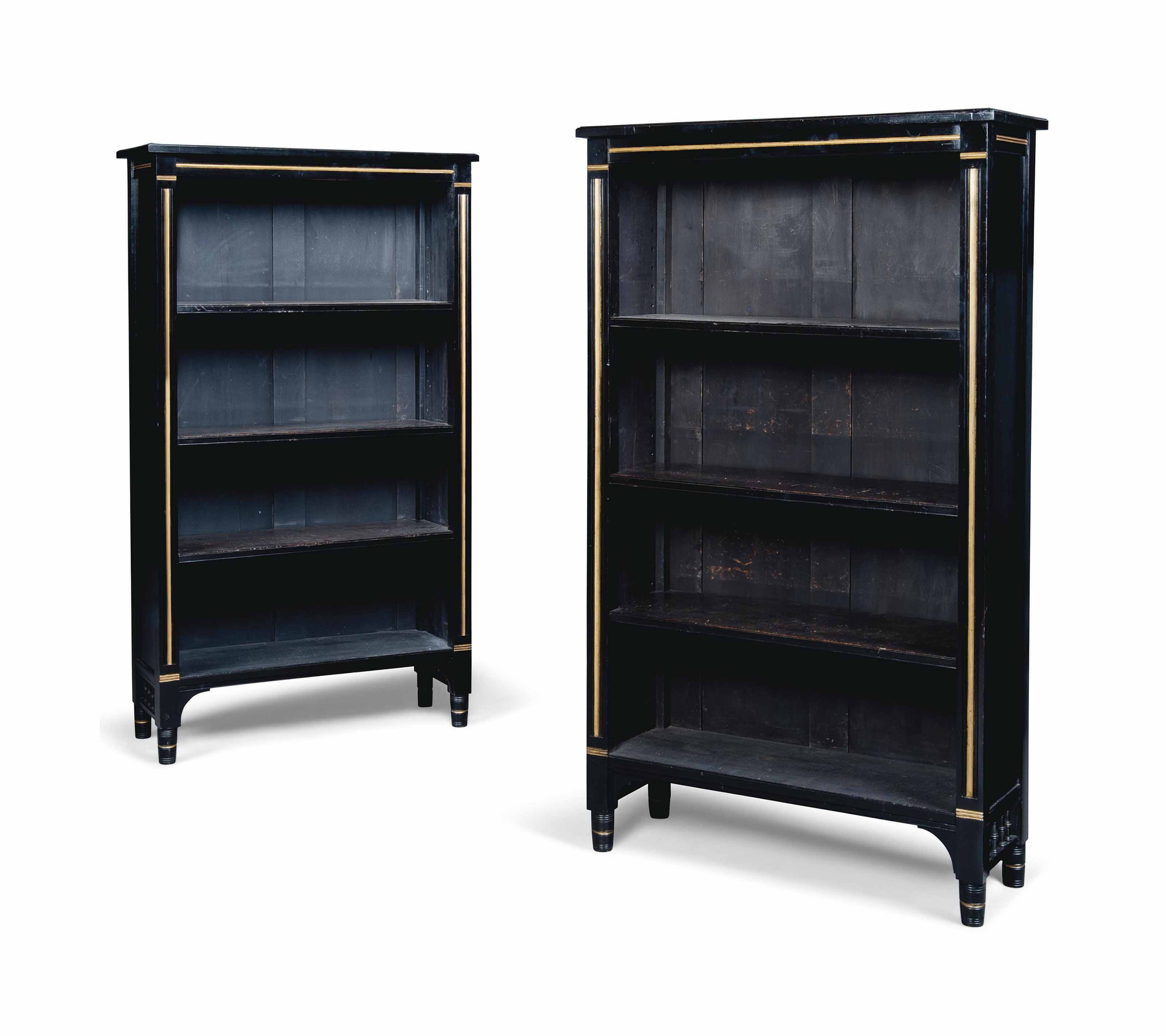 A PAIR OF EBONISED AND GILT-HE