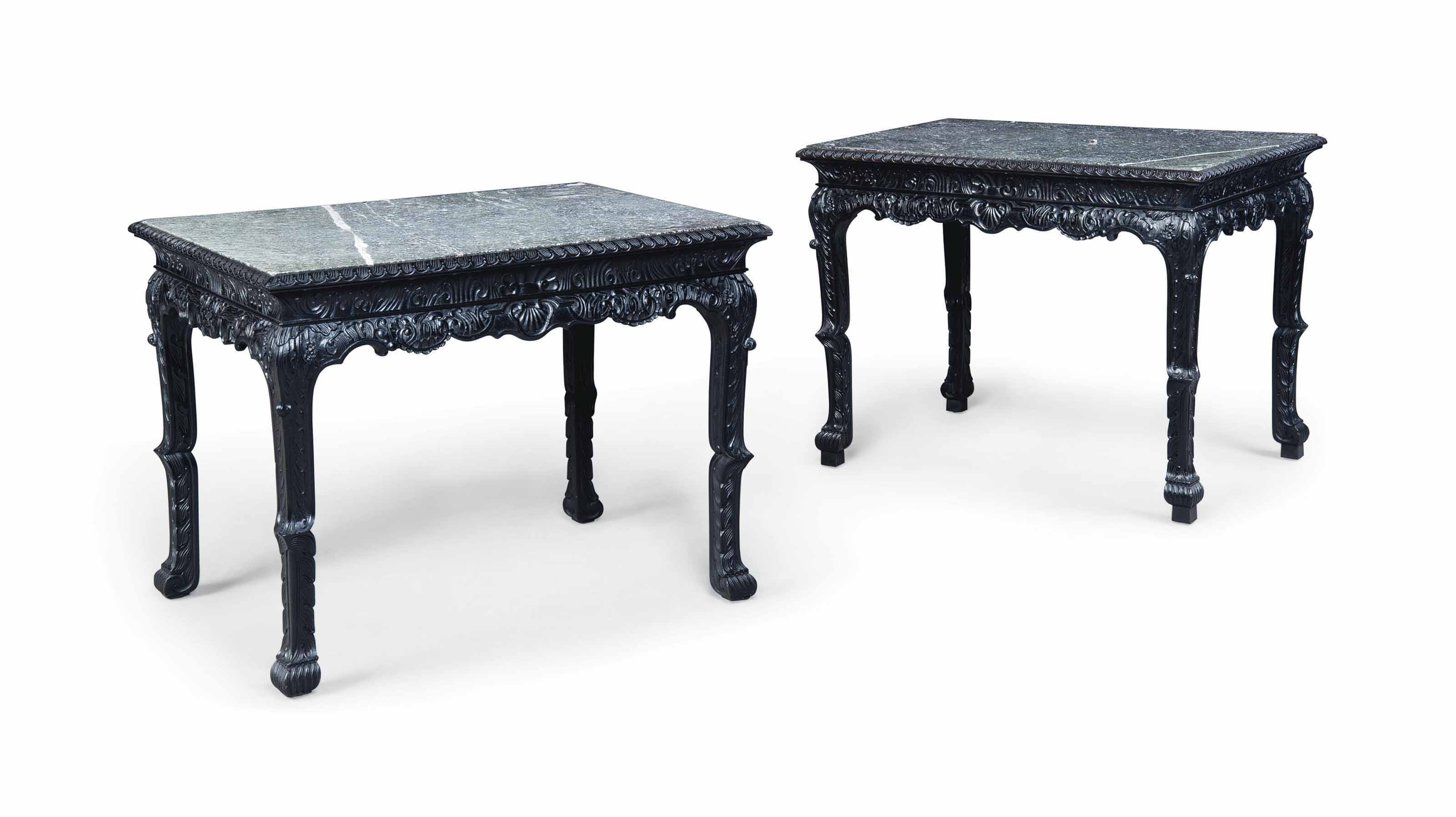 A PAIR OF EBONISED SIDE TABLES