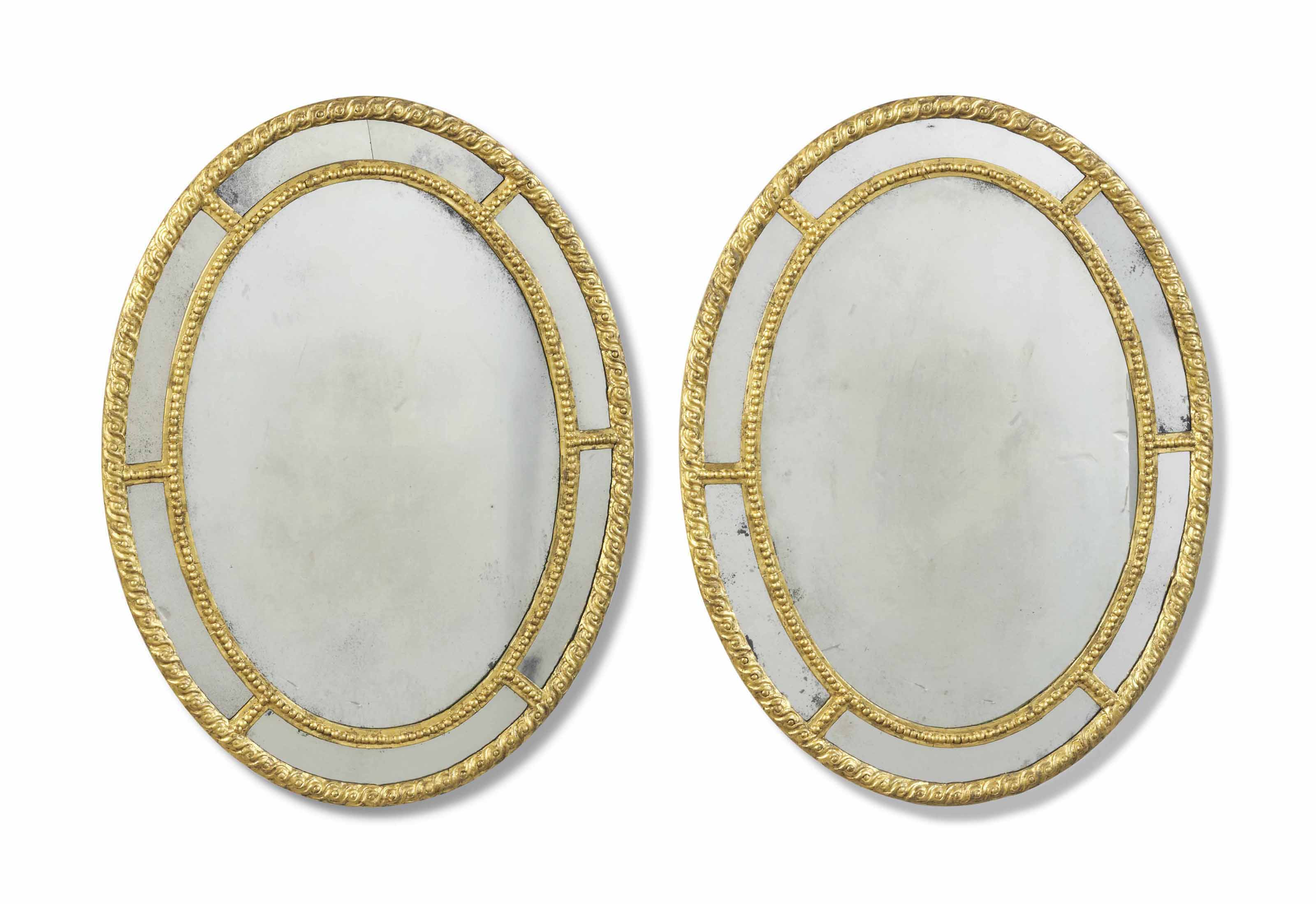 A PAIR OF GILTWOOD OVAL MARGIN
