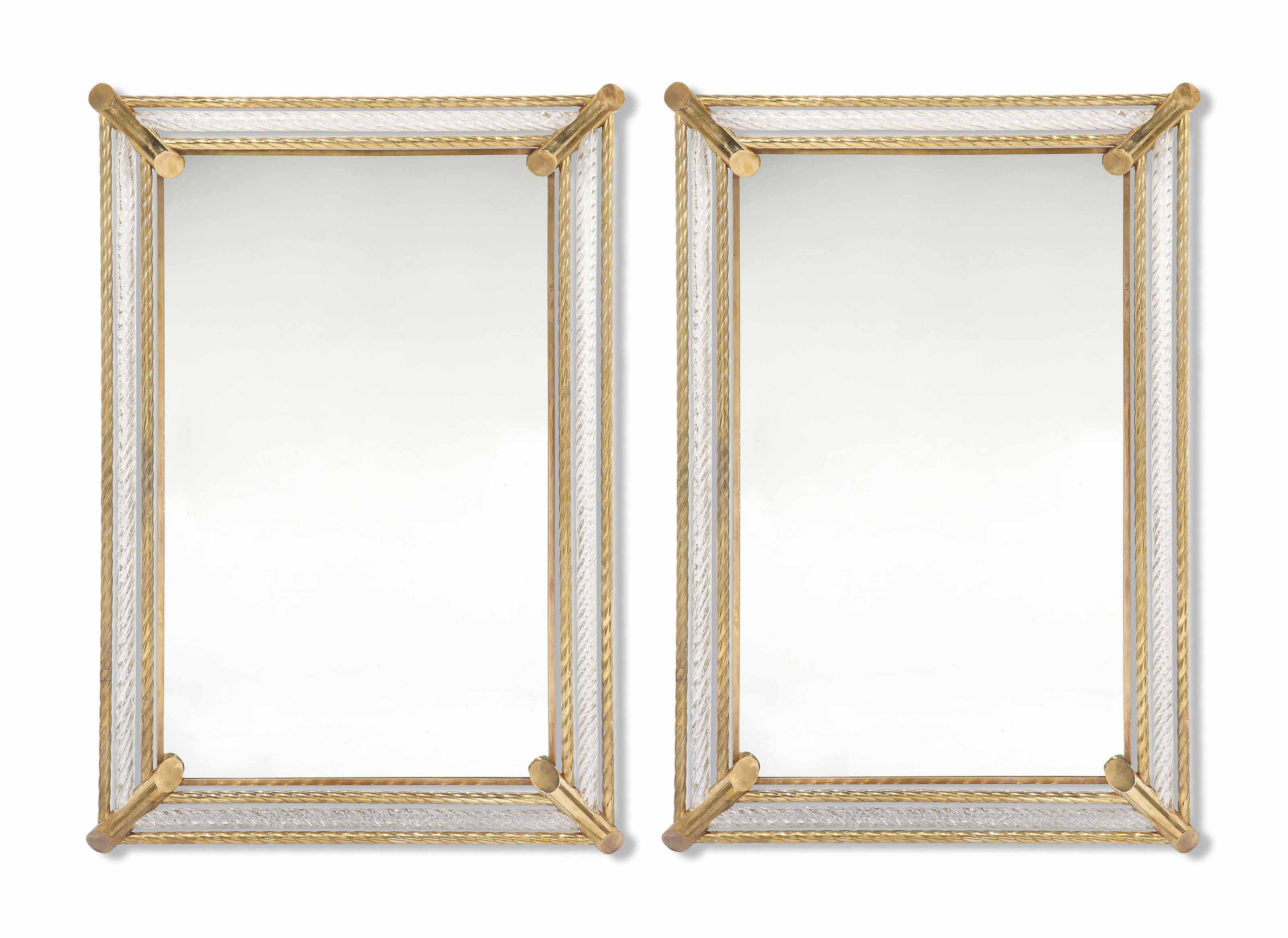 A PAIR OF BRASS AND GLASS MIRR