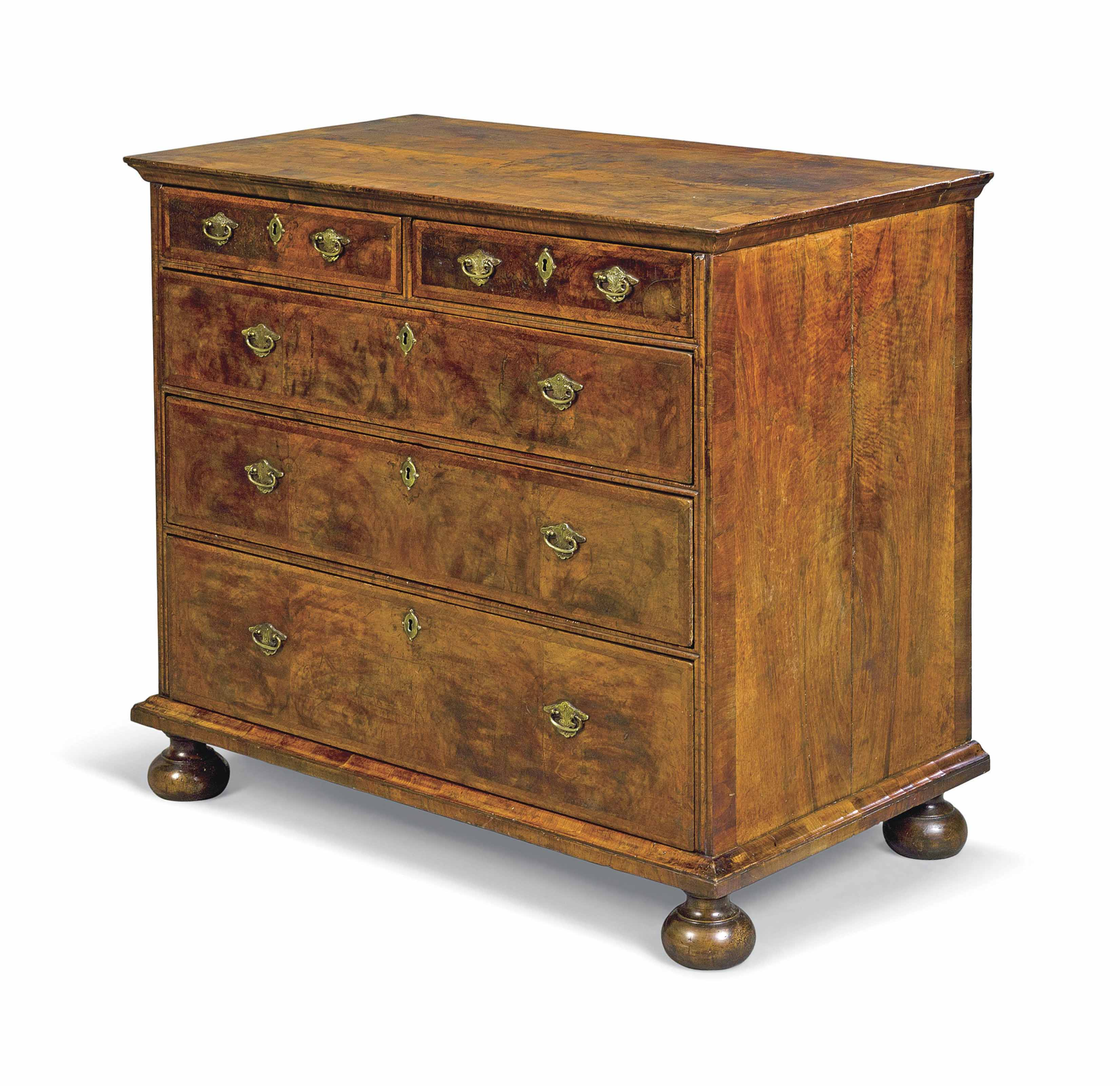 A GEORGE I WALNUT AND FEATHER-BANDED CHEST