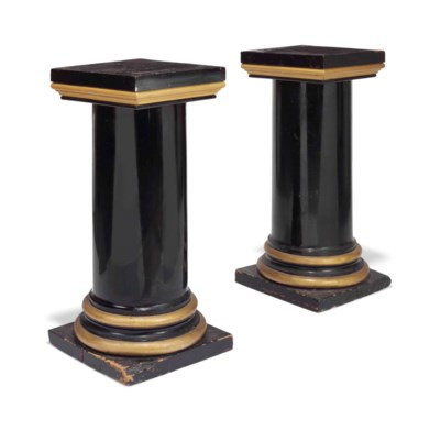 A PAIR OF EBONISED AND GILTWOO
