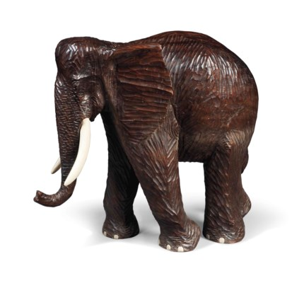 A CARVED HARDWOOD MODEL OF AN