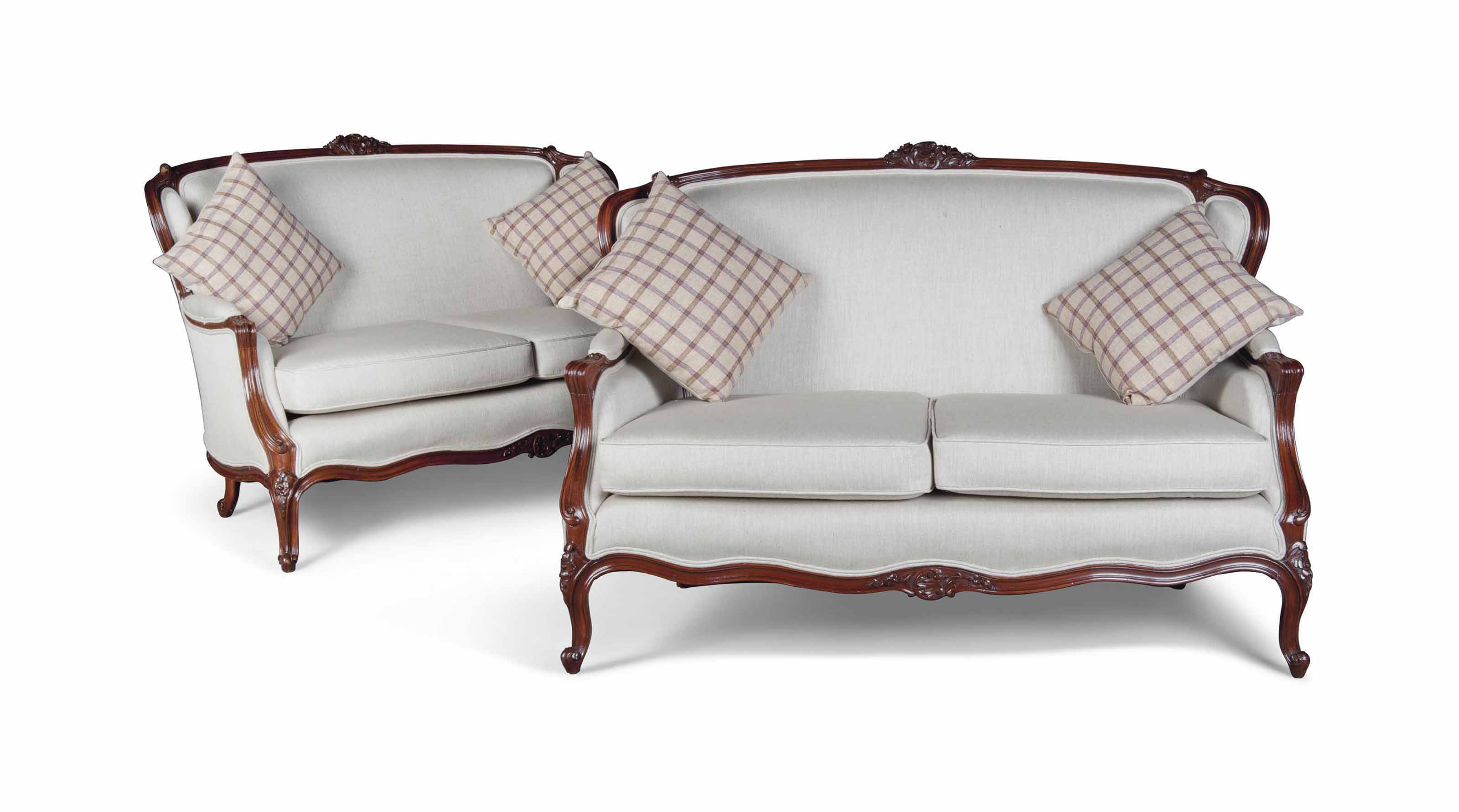 A PAIR OF FRENCH WALNUT SOFAS