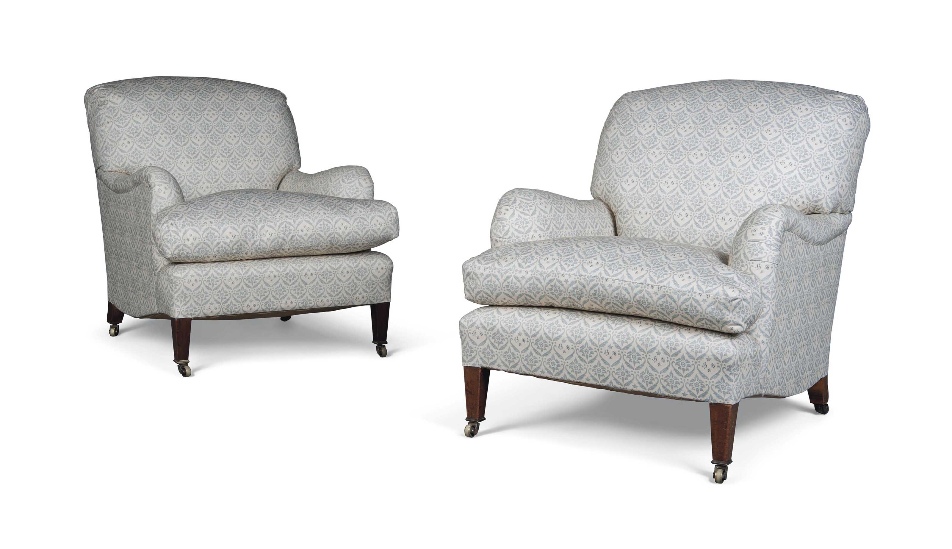 A PAIR OF LATE VICTORIAN OR EDWARDIAN EASY ARMCHAIRS