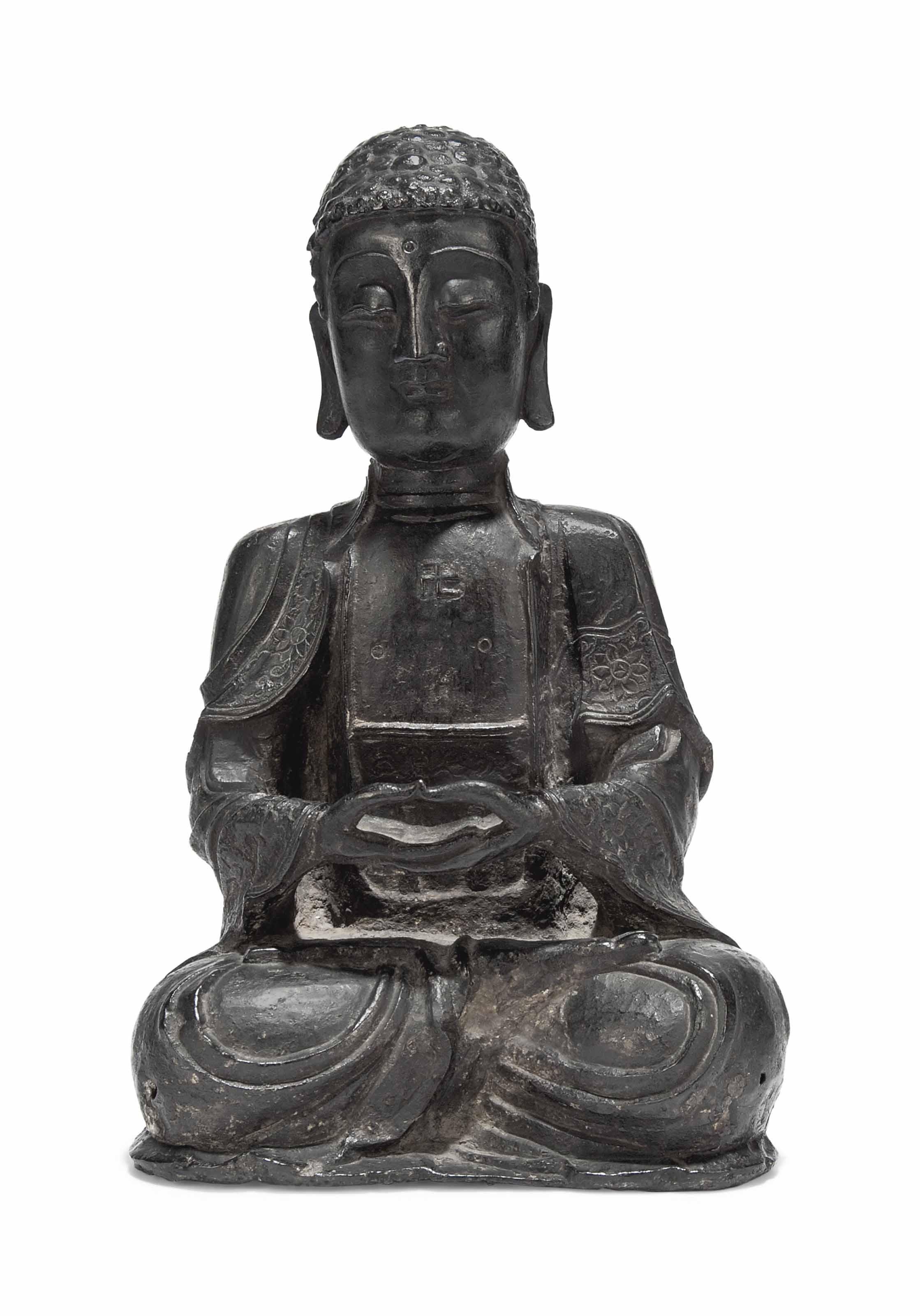 A CHINESE IRON FIGURE OF BUDDH