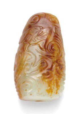 A WHITE AND RUSSET JADE 'CHILO