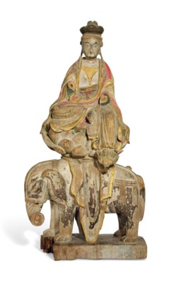 A POLYCHROME WOOD CARVING OF S