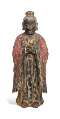 A POLYCHROME-DECORATED CARVED
