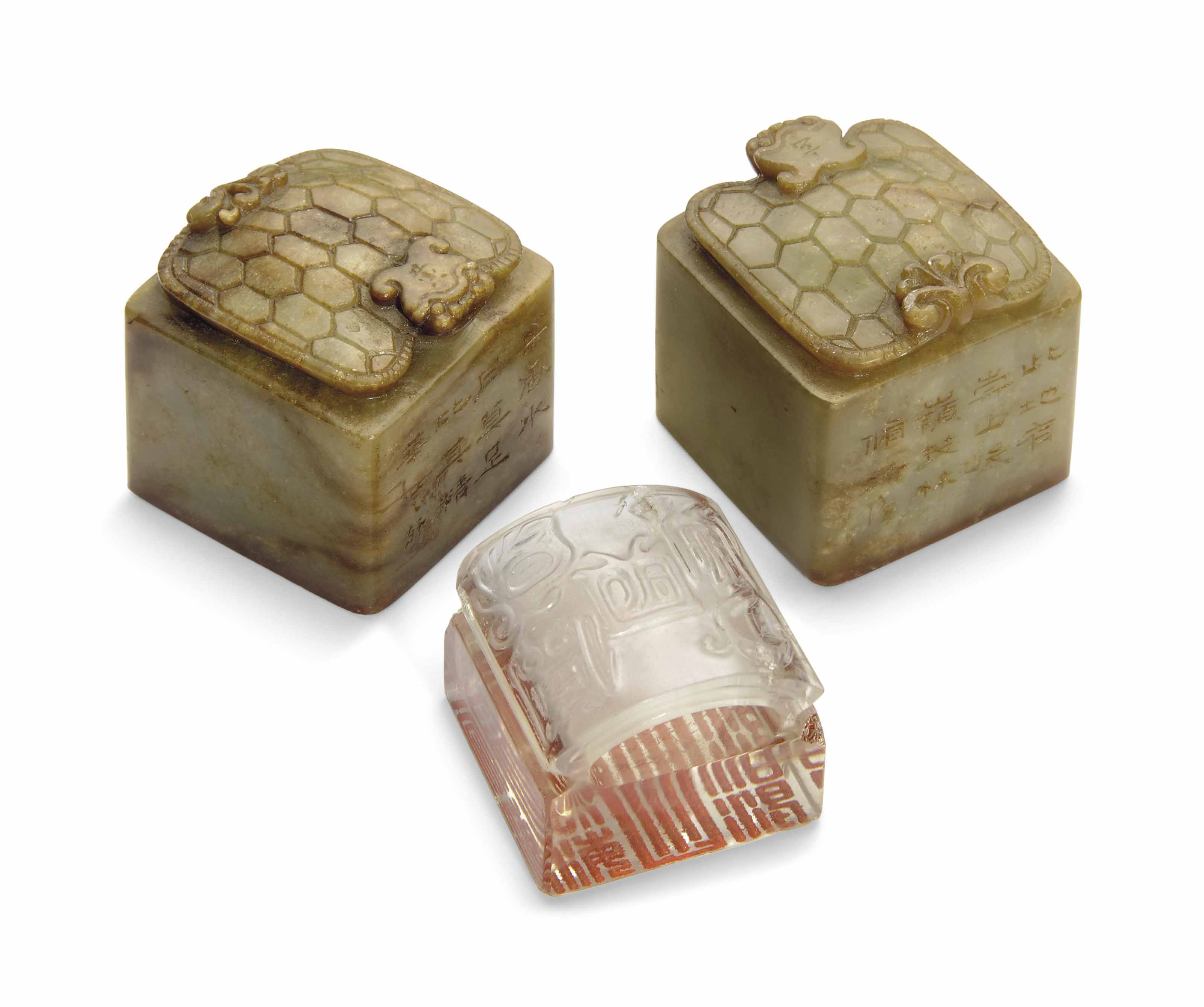 A PAIR OF SOAPSTONE SEALS AND