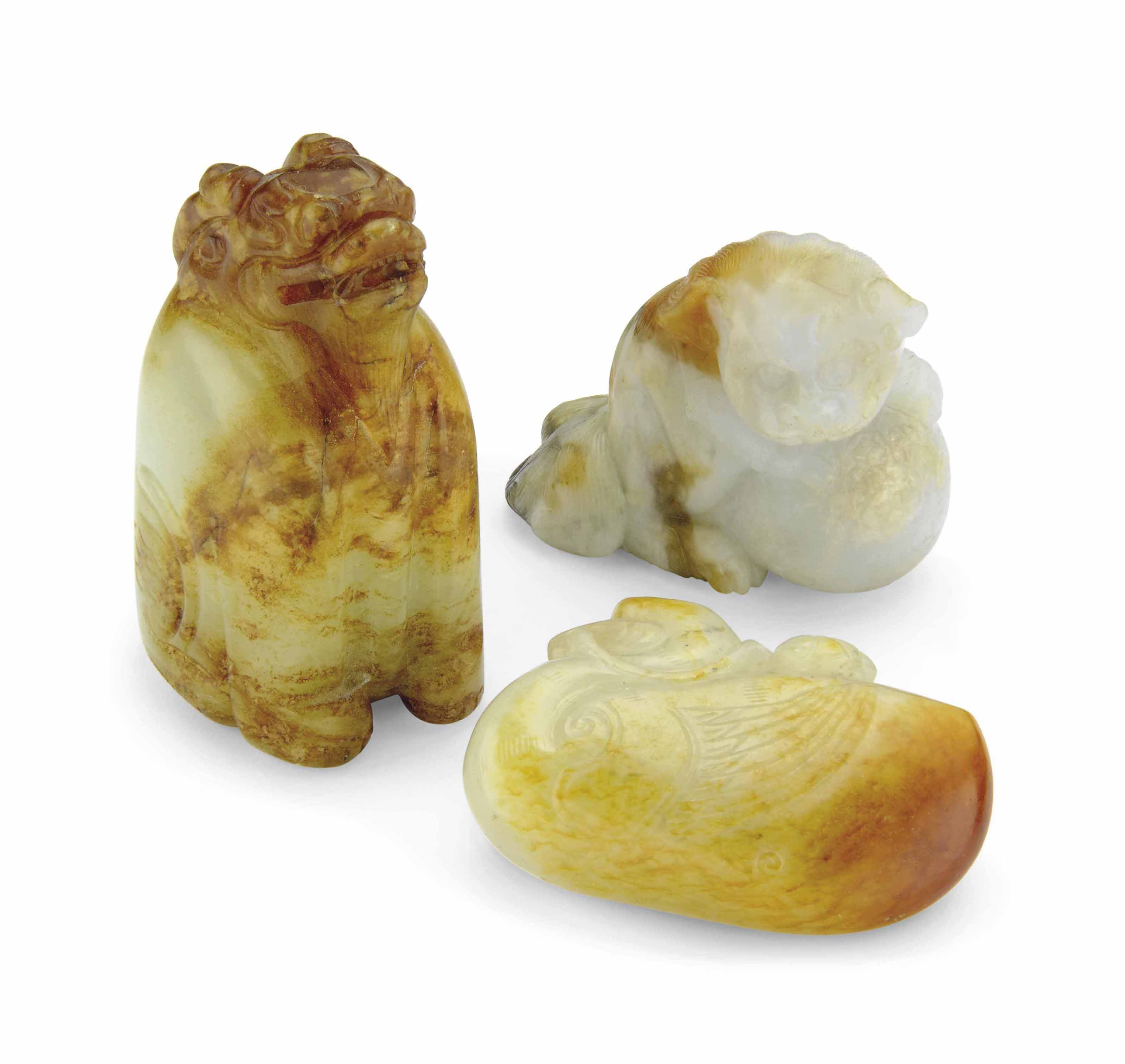 THREE SMALL JADE ANIMAL CARVIN