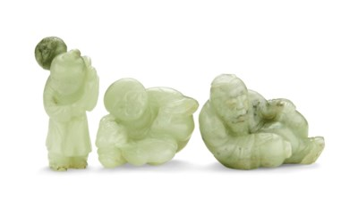 A GROUP OF THREE CELADON JADE