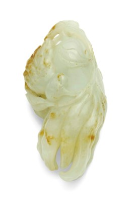 A WHITE AND RUSSET JADE 'FINGE