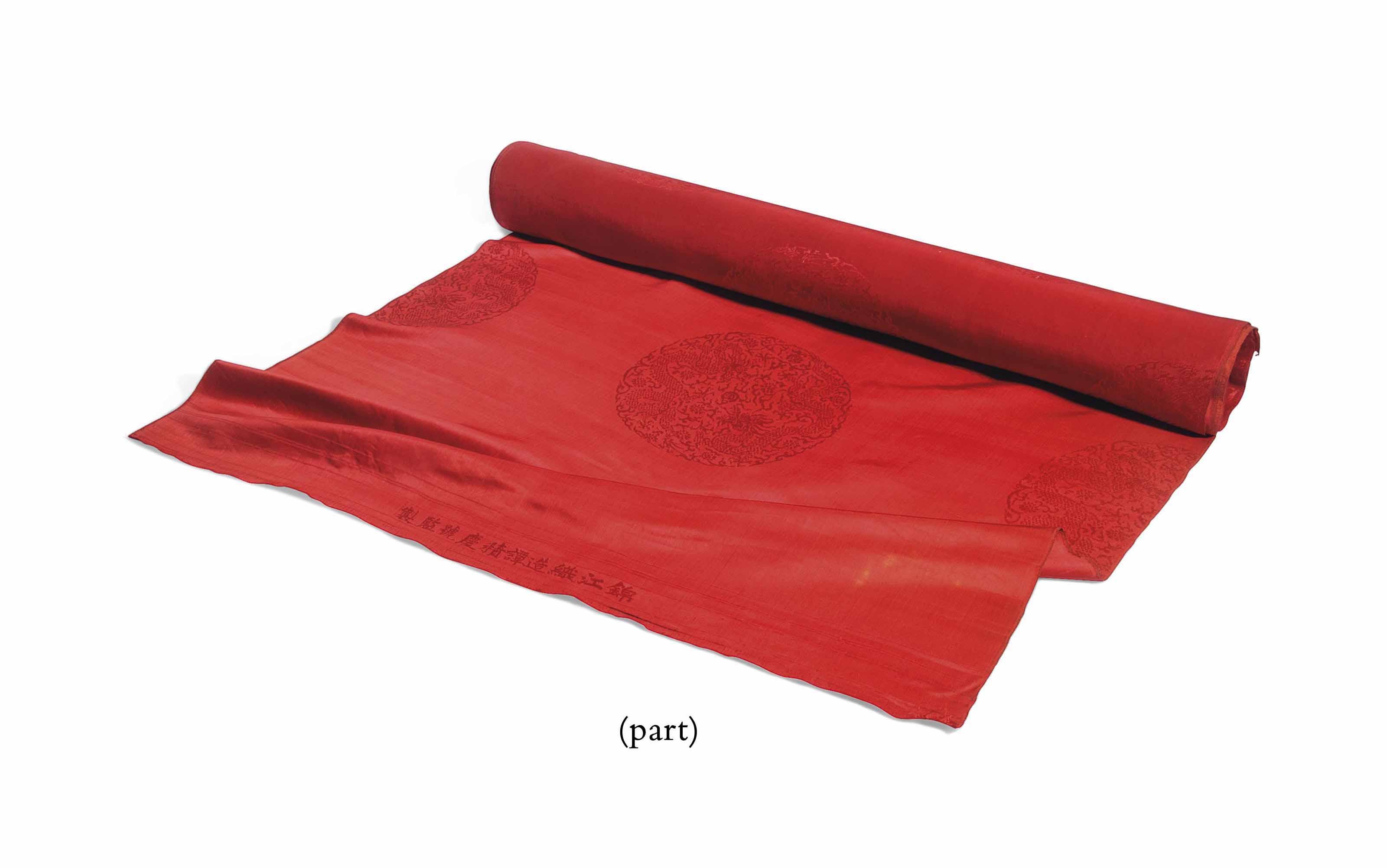 A YARDAGE OF RED BROCADE SILK,