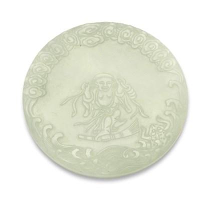 A WHITE JADE CIRCULAR INK PALE