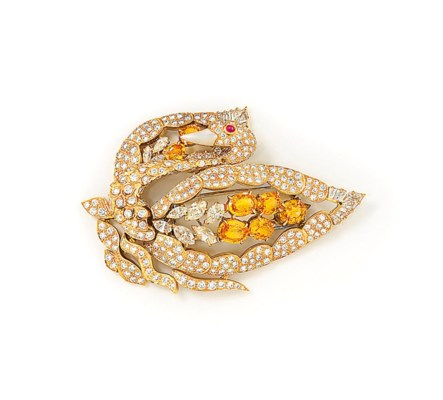 A DIAMOND AND GEM-SET BROOCH,