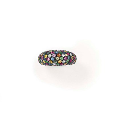 A DIAMOND AND GEM-SET RING, BY