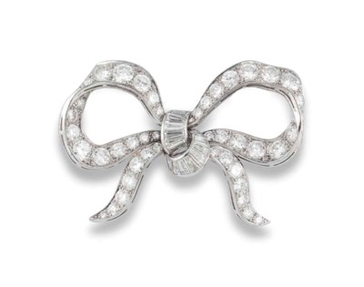 A DIAMOND BOW BROOCH