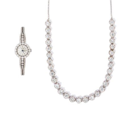 A DIAMOND NECKLACE AND WATCH