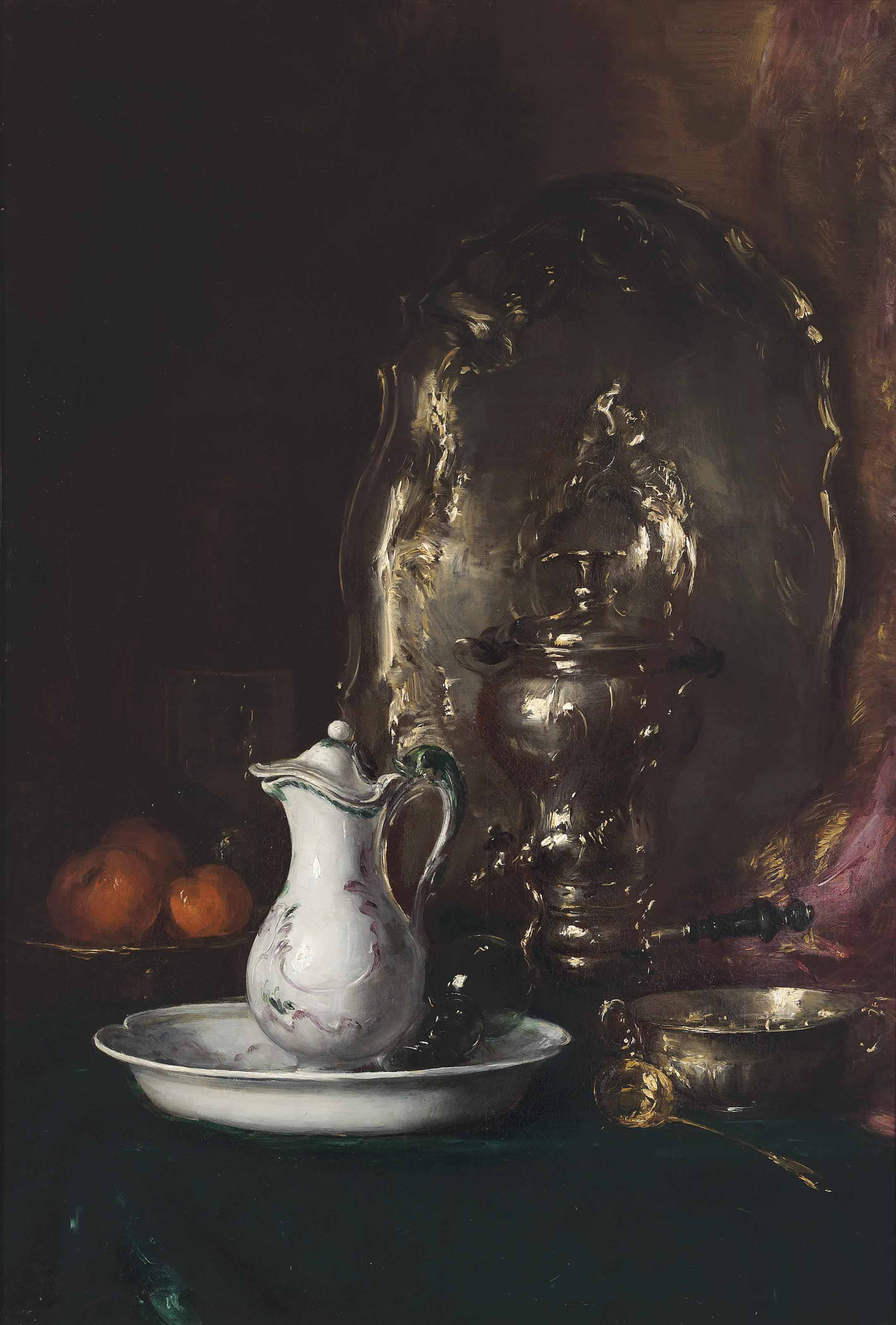 A jug with oranges and a silver salver