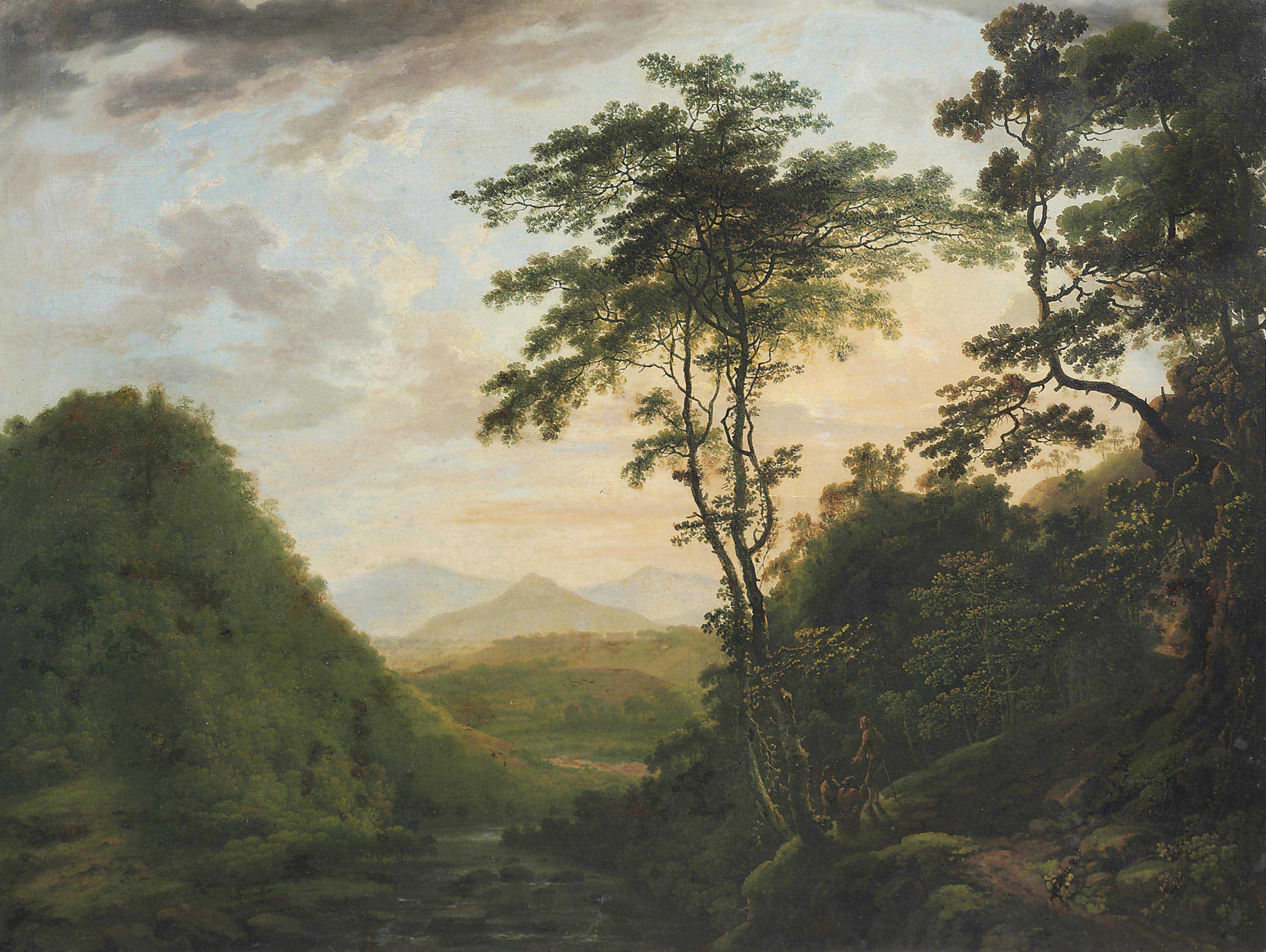 A wooded river landscape looking towards the Sugar Loaf from the Scalp, Co Wicklow, with Powerscourt in the distance