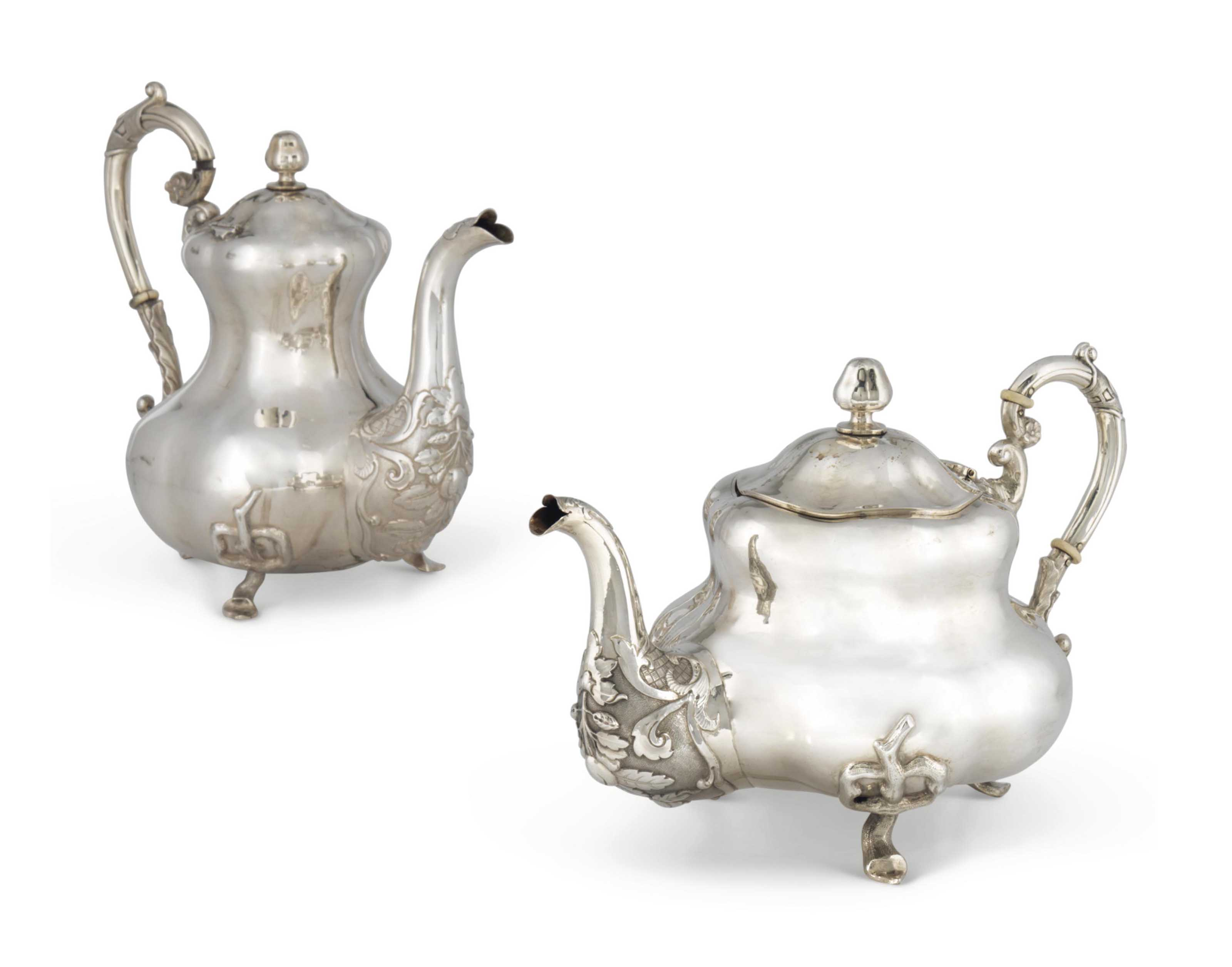 A RUSSIAN SILVER TEAPOT AND A
