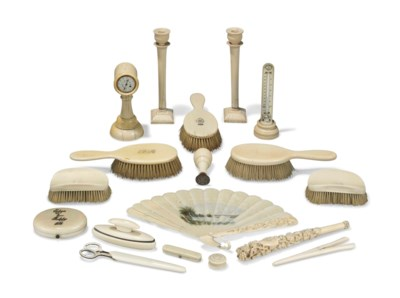 A GROUP OF IVORY DRESSING TABL