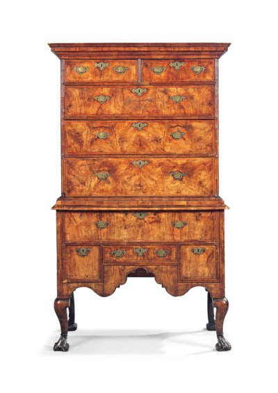 A QUEEN ANNE WALNUT AND FEATHE