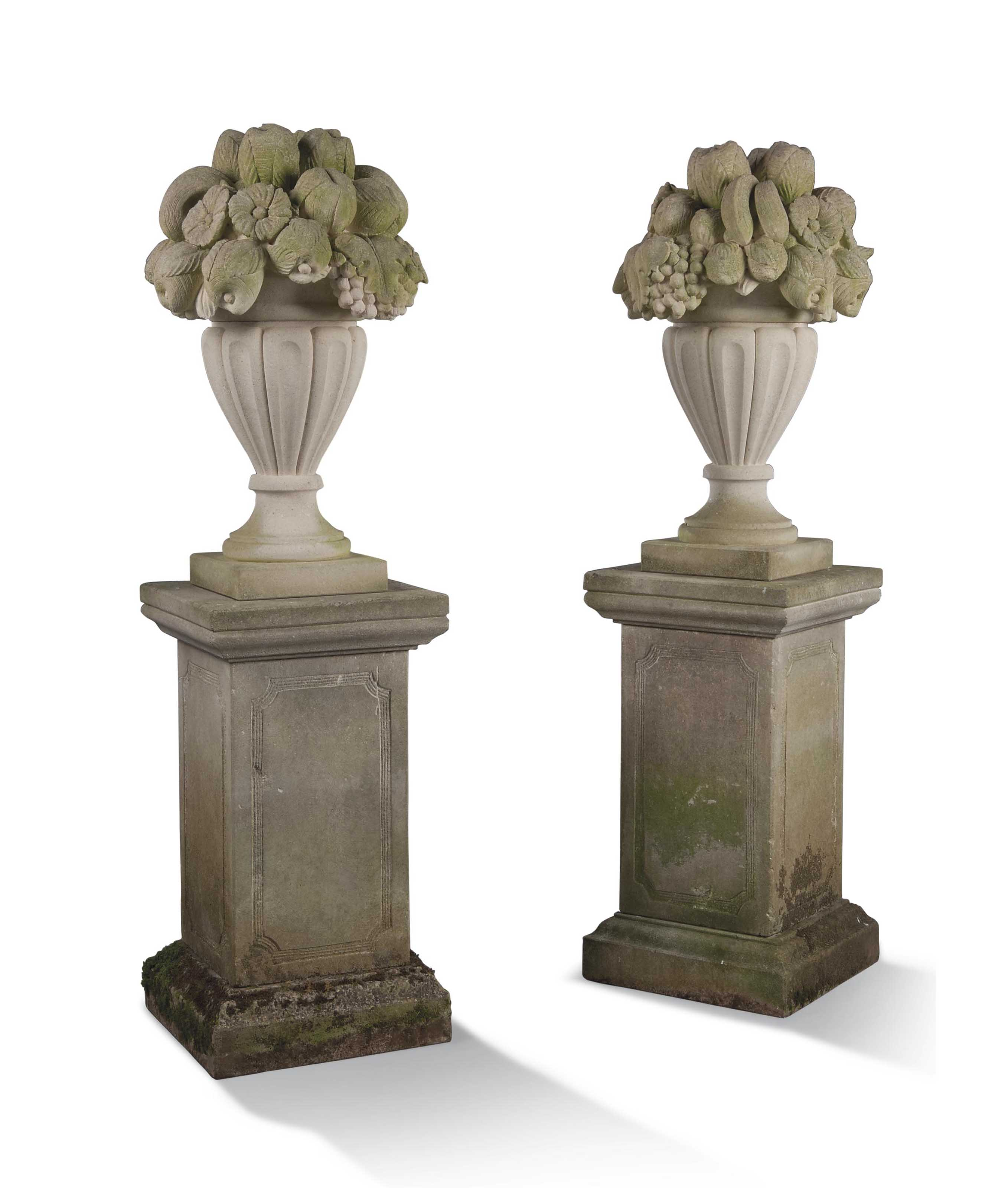 A PAIR OF LIMESTONE FRUIT AND