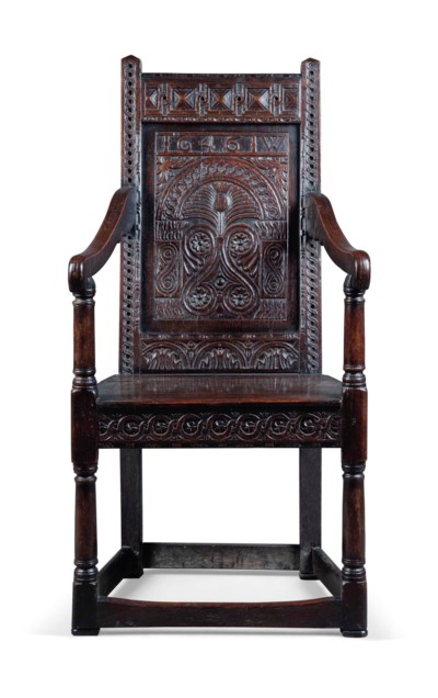 A CHARLES I CARVED OAK ARMCHAI