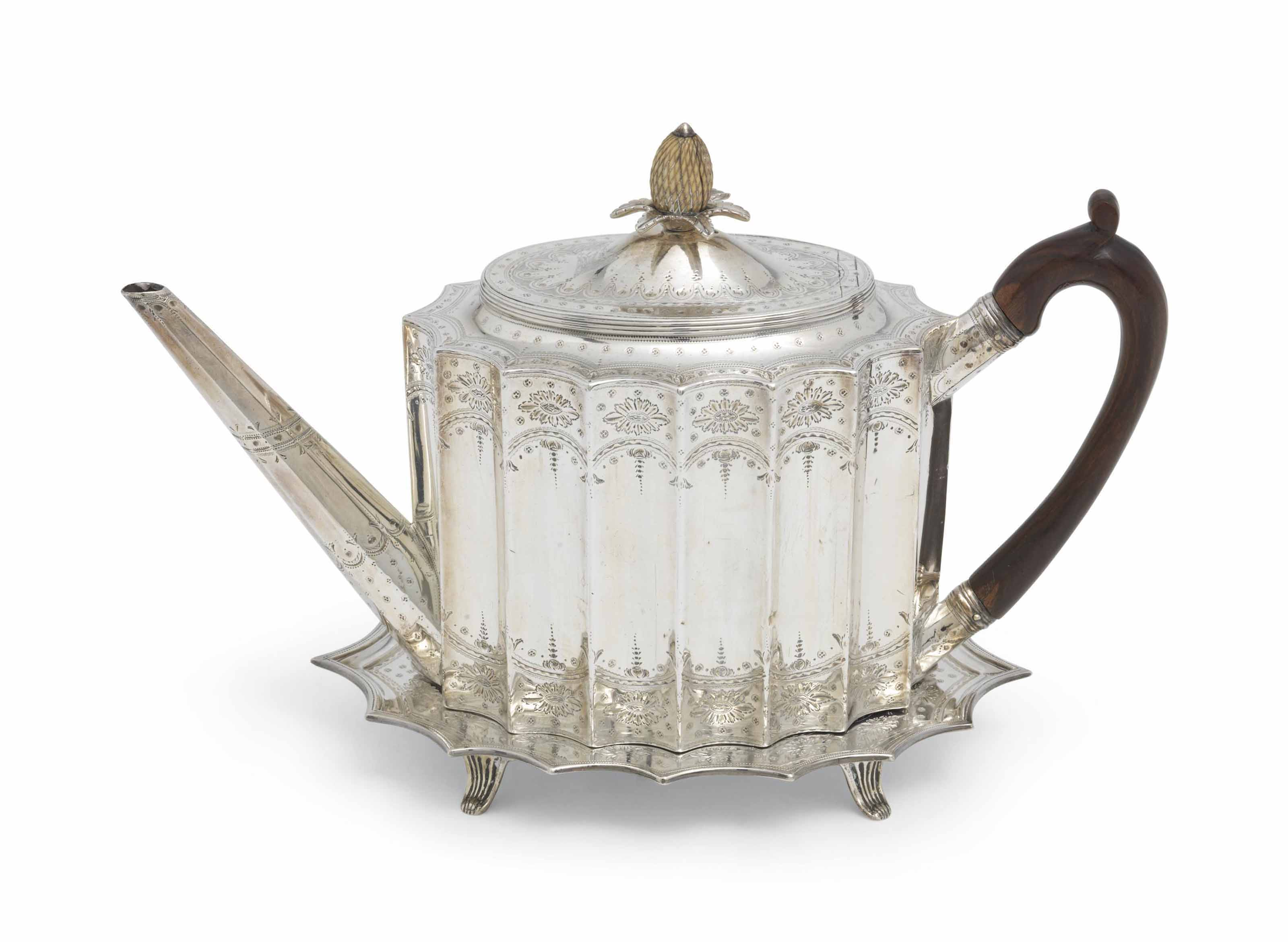 A GEORGE III SILVER TEAPOT AND STAND