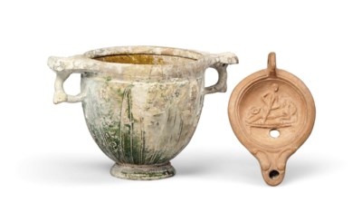A TERRACOTTA OIL LAMP WITH ERO