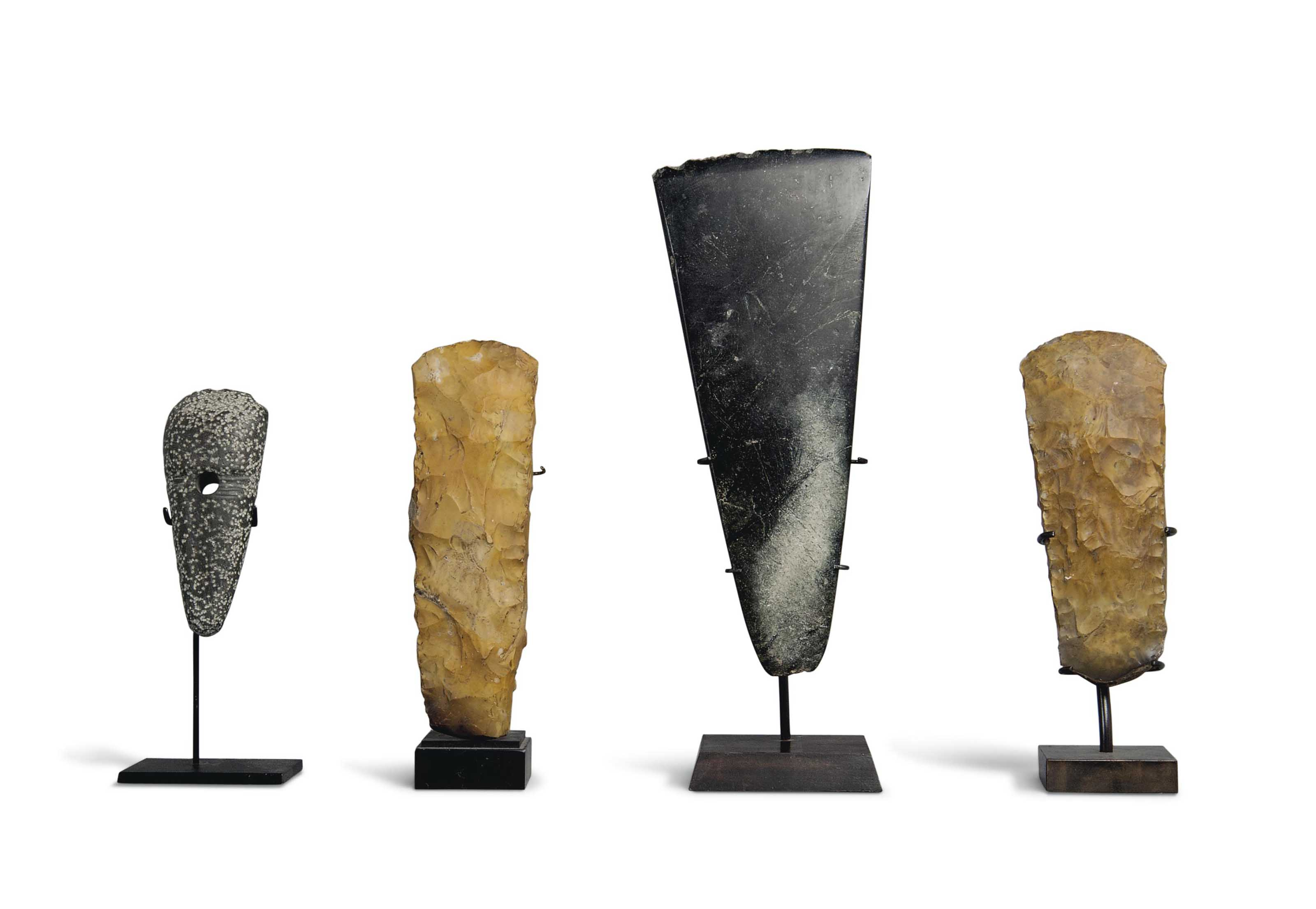 FOUR NEOLITHIC AXE HEADS
