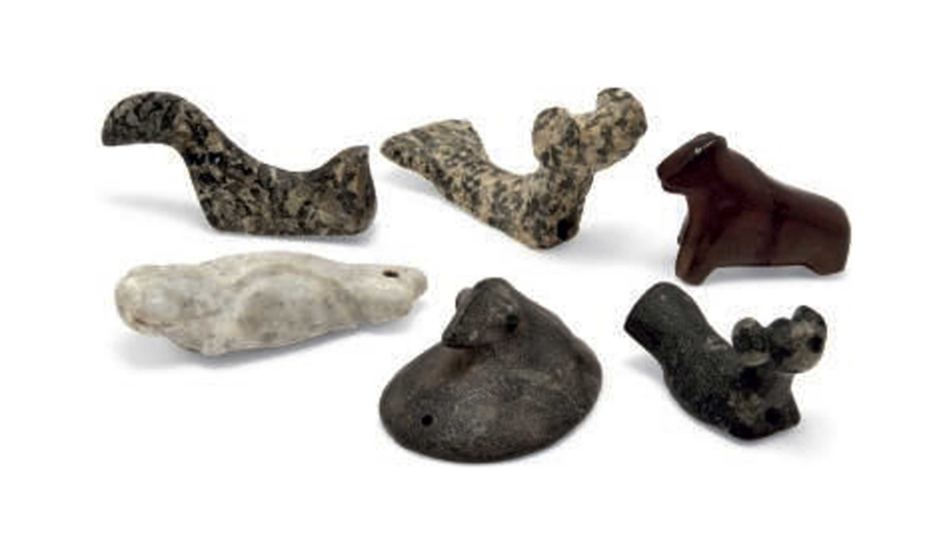 A COLLECTION OF STONE AMULETS