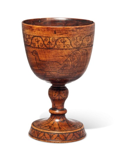 A DECORATED PEARWOOD STANDING