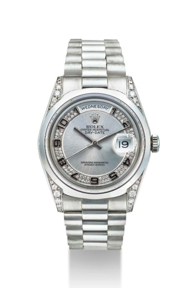 ROLEX. A PLATINUM AND DIAMOND-