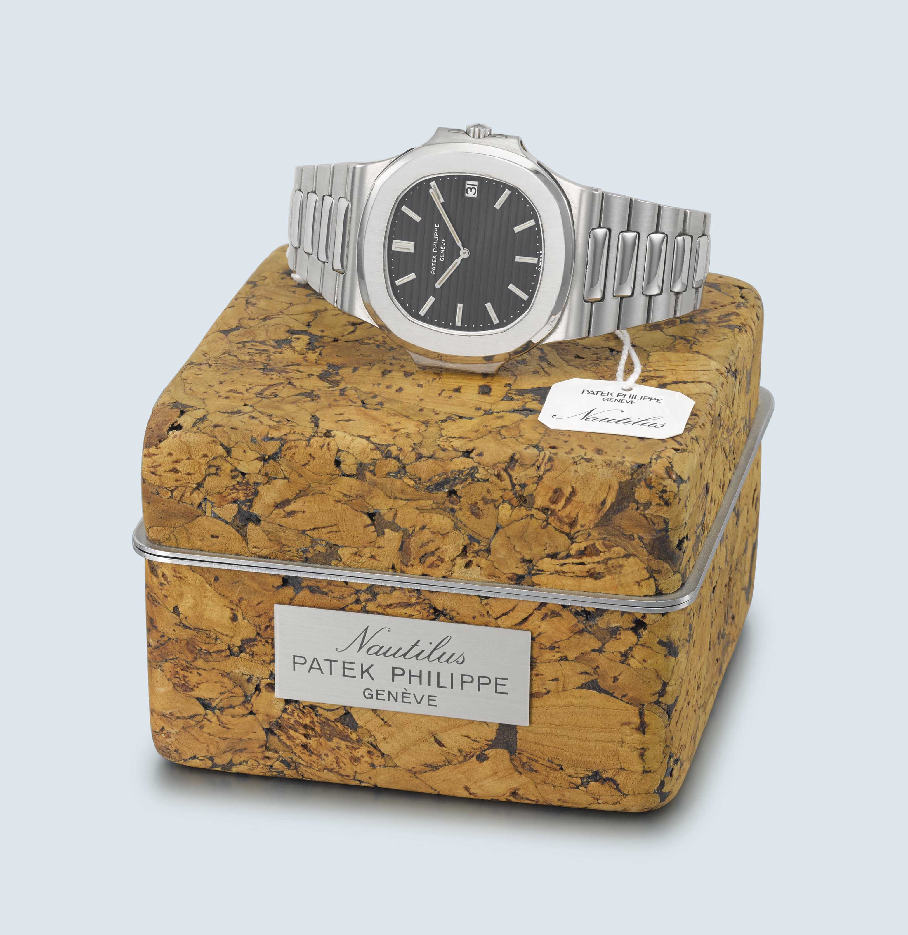 PATEK PHILIPPE. A VERY RARE AND FINE STAINLESS STEEL AUTOMATIC WRISTWATCH WITH DATE, BRACELET AND ORIGINAL NAUTILUS CORK BOX